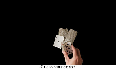 Hands of man throws card pack or deck on the table.