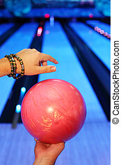 Hands of man, which holds red ball and prepares to throw in...