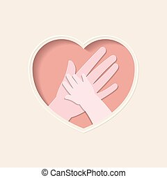 Hands of mother and baby in heart shaped paper art