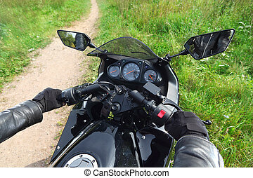 hands of motorcyclist  on country road, control panel