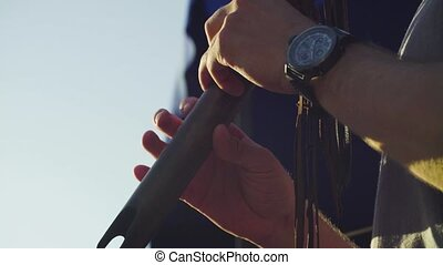 Hands of musician playing ethnic flute - Close up hands of ...