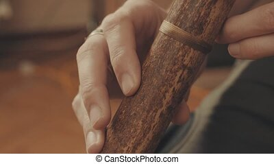 Hands of musician plays the flute. Close up 4K