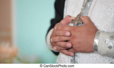 hands of  priest in the Church