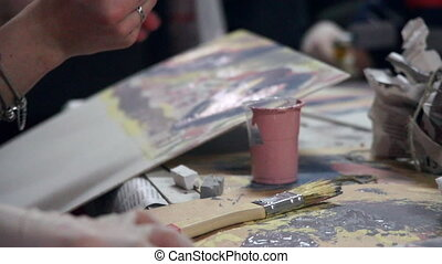 Hands of professional craftsmen decorate paper. Process in design studio.