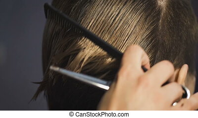 Hands of professional hair stylist. Hairstyle for a girl...