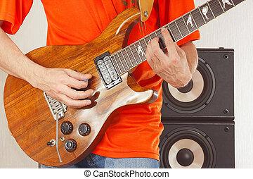 Hands of rock musician put guitar chords