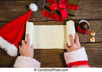 Santa Claus opening blank scroll