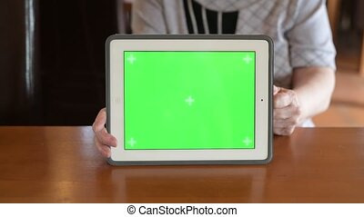 Hands Of Senior Woman Giving Thumbs Up While Showing Digital Tablet