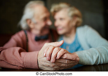 Hands of seniors - Close-up of senior female hand in that of...