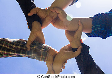 Hands of success startup business teamwork, Sky background,  Creative idea teamwork concept. Group of multiethnic diverse team