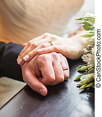 Hands of the bride and groom close-up