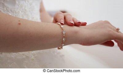 Hands of the bride dress nice bracelet