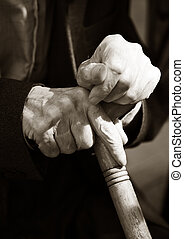 Hands of the elderly man. B/w+sepia