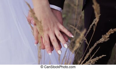 Worried Bridegroom And Fiancee Cling To Each Other - Hands...
