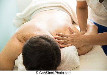 Hands of therapist giving a massage