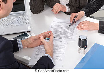hands of three people, signing documents