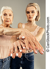 Hands of two women being shown to you