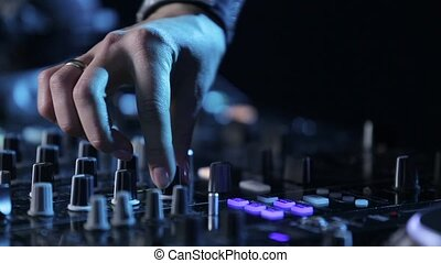 Hands of woman Dj play music on mixing console, party