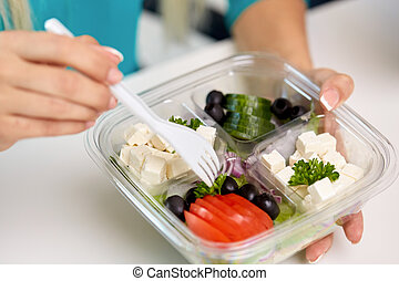 hands of woman eating take out food from container - lunch ...