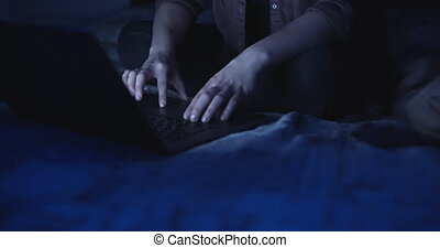 Hands of woman using a laptop