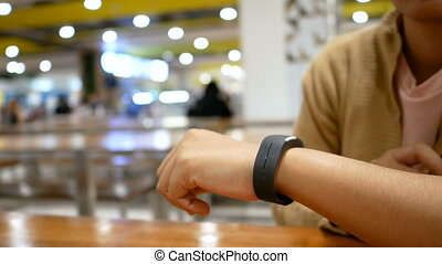 Hands of woman using smart watch for cyber and futuristic...
