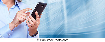 Hands of woman with a smartphone. Over blue background.