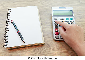 Hands of woman Working with Calculator