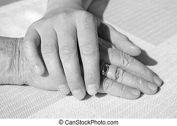 hands of young and a senior woman for comfort