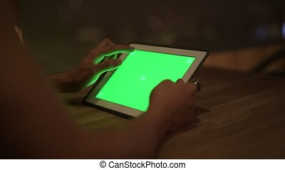 Hands of young Asian man using digital tablet