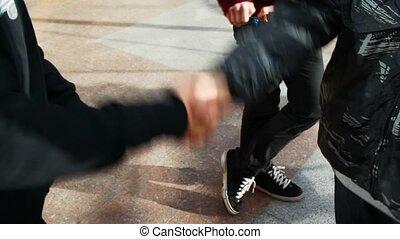 hands of young men commit friendly handshake twice - hands...