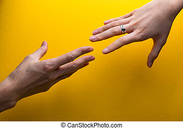 hands on a yellow background