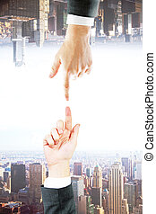 Hands on city background
