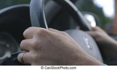 Hands on Steering Wheel - Handheld, interior, close up shot...