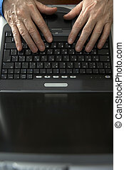 hands on the laptop