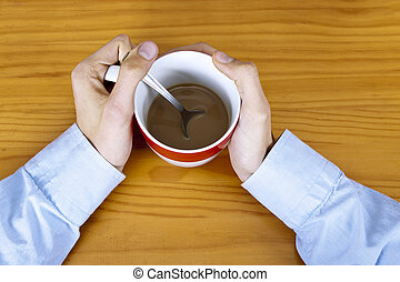 hands on the table with cup of coffee