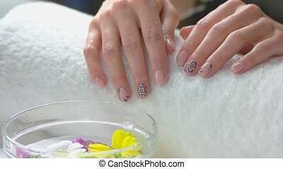 Hands on white towel, slow motion. Beautiful female hands...