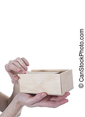Hands opening box