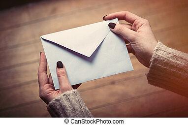 hands opening envelope