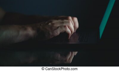 Hands or man office worker typing on the keyboard at night
