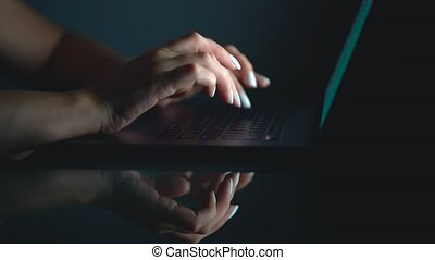 Hands or woman office worker typing on the keyboard at night
