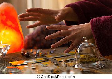 Hands over tarot cards