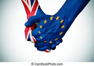 hands patterned with the British and the European flag