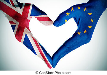 hands patterned with the British and the European flag forming a heart
