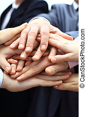 Hands piled on top of one another. - Hands piled on top of...