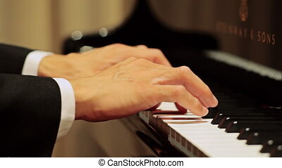 Hands play piano
