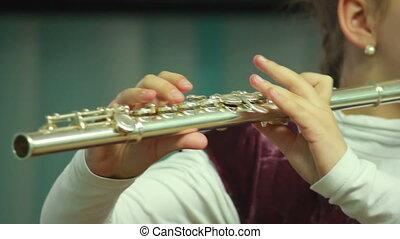 Hands play wind instrument