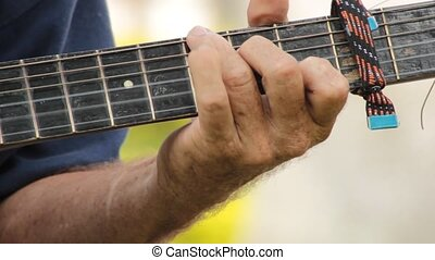Hands Playing Guitar Strings