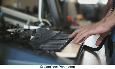 Hands playing on electric piano - Detail of hands playing...