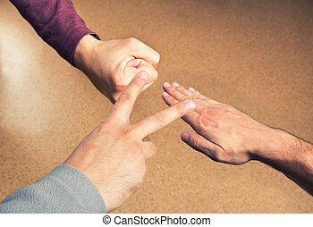 Hands playing paper rock scissors