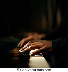 Hands playing piano close-up - Hands of pianist playing...